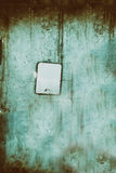 Empty plate on a concrete wall. Royalty Free Stock Photo