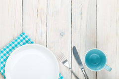 Empty plate, cup and silverware Royalty Free Stock Images