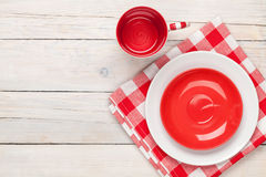 Empty plate, cup and towel. Over wooden table background. View from above with copy space Stock Images