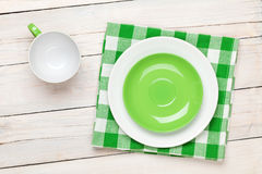 Empty plate, cup and towel. Over wooden table background. View from above with copy space Stock Photos