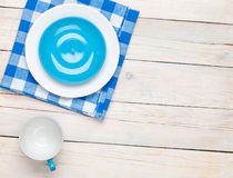 Empty plate, cup and towel. Over wooden table background. View from above with copy space Stock Photography