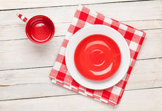 Empty plate, cup and towel over wooden table background. View from above with copy space Stock Images