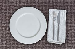 Empty plate and cutlery on multiplex plate.  Stock Photos