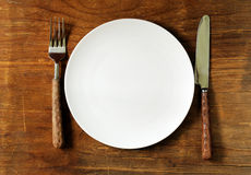 Empty plate with cutlery and napkin Royalty Free Stock Photo