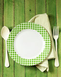 Empty plate with cutlery and napkin Stock Photography
