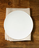 Empty plate with cutlery and napkin Stock Photos