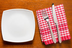 Empty plate and cutlery prepared supper on the table Royalty Free Stock Photography