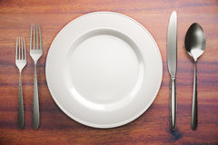 Empty plate and cutlery Royalty Free Stock Photo