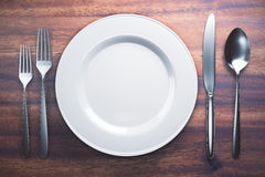 Empty plate and cutlery Royalty Free Stock Photos