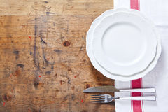 Empty plate with cutlery on a wooden background. space for writi. Ng or placing text menu Royalty Free Stock Photo