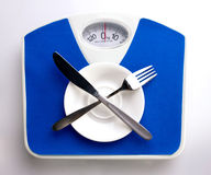 Empty plate for dieting concept Royalty Free Stock Photography