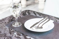 empty plate on dinning table Royalty Free Stock Images
