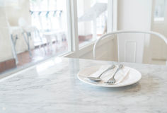 empty plate on dinning table Royalty Free Stock Photo