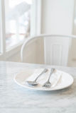 empty plate on dinning table Stock Photos