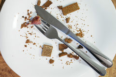 Empty plate after eating. An empty plate, dirty after the meal is finished. View from above stock image