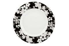 Empty plate with floral decoration with c/p. Empty plate with floral decoration on white background, with clipping path royalty free stock image