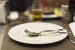 Empty plate of food after meal on a table Royalty Free Stock Images