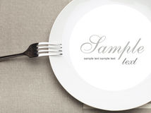 Empty plate with fork Royalty Free Stock Photos