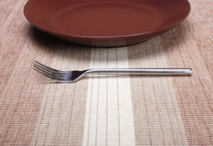Empty plate with fork Royalty Free Stock Image