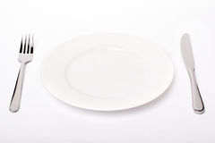 Empty Plate, Fork And Knife Royalty Free Stock Photography