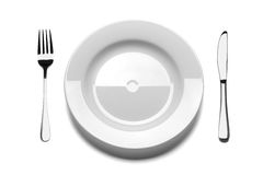 Empty plate with fork and knife. Stock Photo