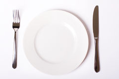 Empty plate, fork and knife Stock Photography