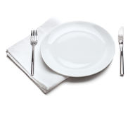 Empty plate with fork and knife Stock Photography