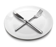 Empty plate with fork and knife Stock Photo