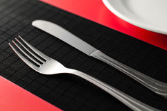 Empty plate with fork and knife Royalty Free Stock Photography