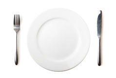 Empty plate, fork and knife Stock Images