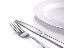 Empty plate, Fork and knife Stock Image