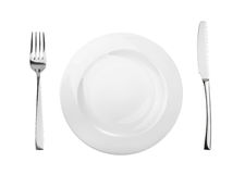 Empty plate, fork and knife isolated on white, without shadow.  royalty free stock image