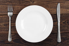 Empty plate, fork and knife Royalty Free Stock Photo