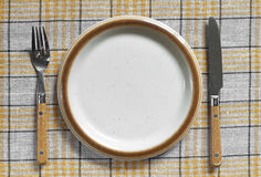 Empty plate, fork and knife Royalty Free Stock Image