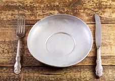 Empty plate fork and knife Stock Image