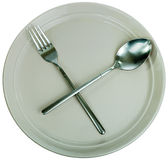 Empty plate, fork and spoon Stock Photo