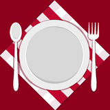 Empty plate with fork and spoon Stock Image