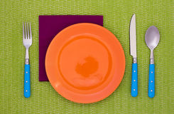 Empty plate with fork, spoon and knife Stock Photo
