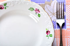 Empty plate and fork on table Royalty Free Stock Photo