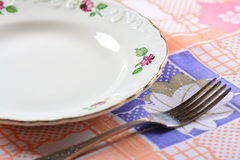 Empty plate and fork on table Royalty Free Stock Photos