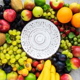 Fresh summer fruits. Empty plate and fresh summer fruits on a concrete background stock photography