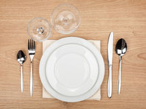 Empty plate, glasses and silverware set. On wooden table Stock Image