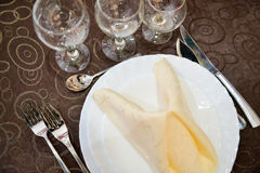 Empty plate, glasses, silverware, table cloath Stock Photo