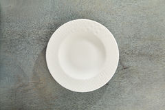 Empty Plate on Gray Wood. Table Background Stock Photo