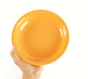 Empty plate in hand Stock Photos