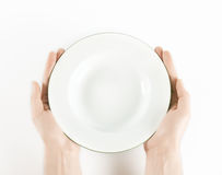 Empty plate in hand Royalty Free Stock Image