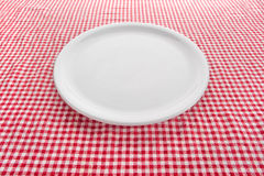 Empty plate on kitchen table Royalty Free Stock Images