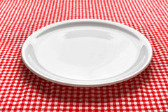 Empty plate on kitchen table stock photography