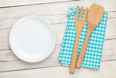 Empty plate and kitchen utensil Royalty Free Stock Photos