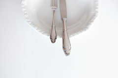Empty plate with knife and fork , beautiful cutlery Royalty Free Stock Images
